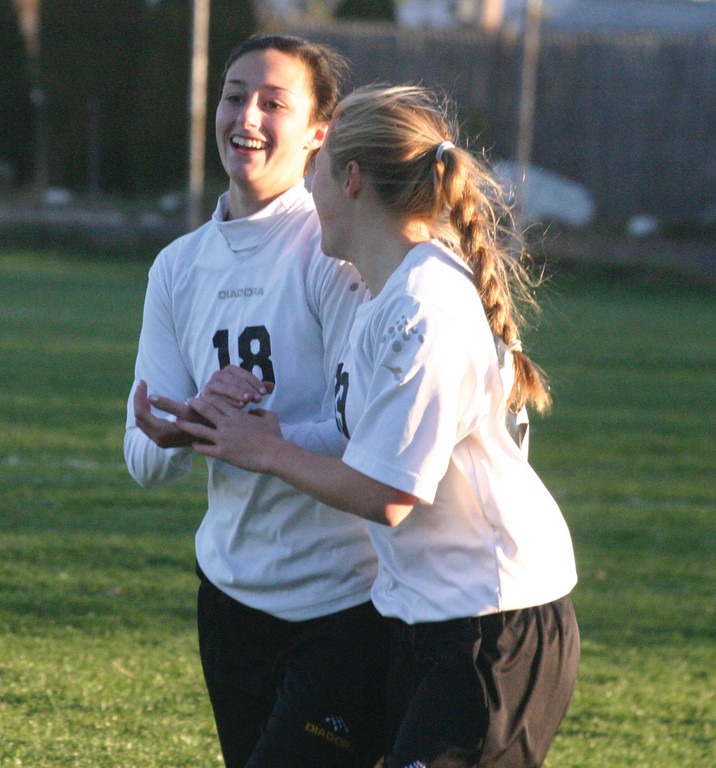 FINISHING TOUCH: Talia D'Ambruoso and Nicole Starkey celebrate the victory on Tuesday.