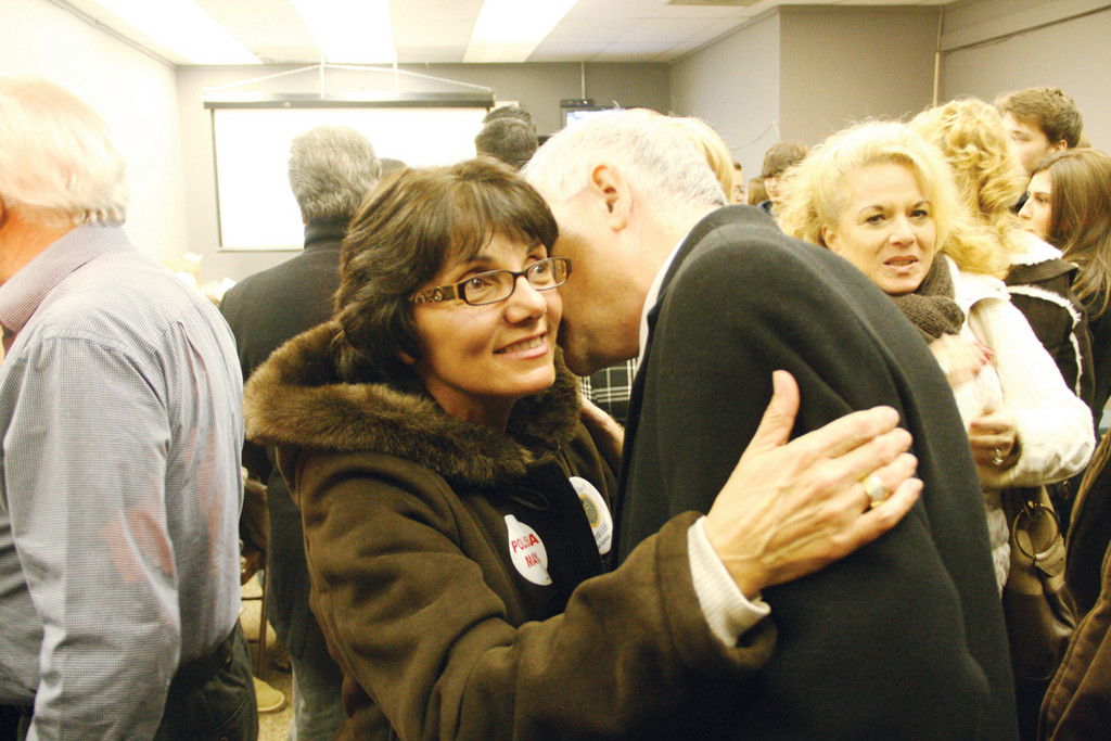 Mayor Joseph Polisena gives a congratulatory kiss on the cheek to Rep. Deborah Fellela, a Democrat who surived a challenge from second-time Independent candidate Karin Gorman for the Dist. 43 House seat. Fellela was in tears at the Democrat's headquarters on Atwood Avenue, thrilled with the outcome of the election.