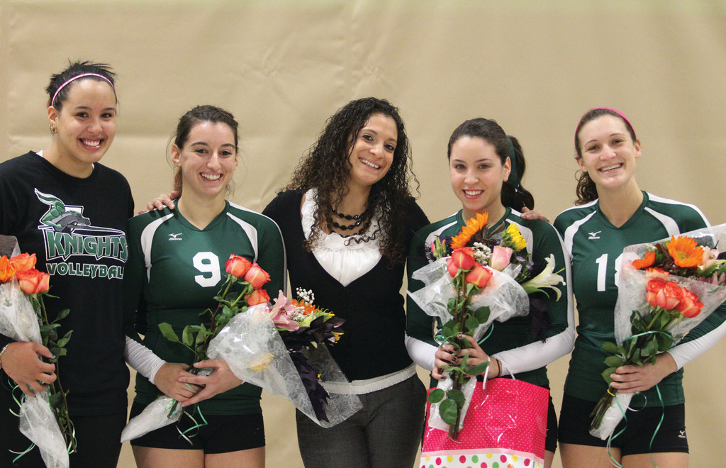 STRONG SEASON: The CCRI sophomore on the volleyball team and head coach Samantha Amaral pose for a picture together.
