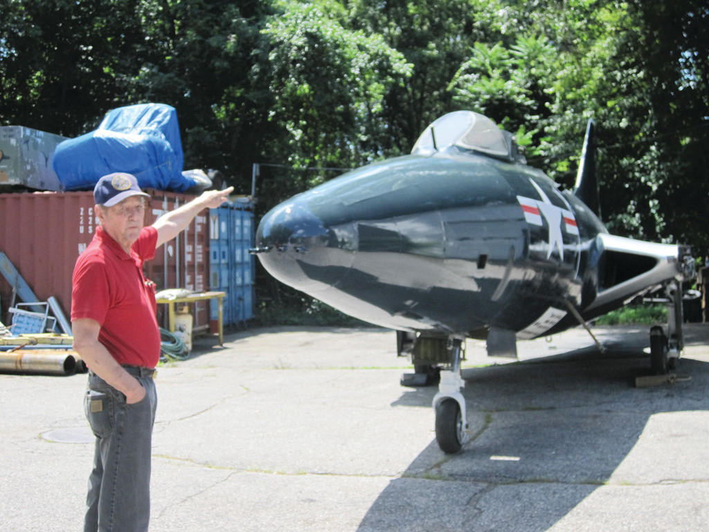 PRIDE AND JOY: Warwick Naval Air veteran Stan Essex likes the way other veterans react to the way he restores naval artifacts for the former USS Saratoga Museum Foundation. This is a P6F Panther jet fighter, the first jet used in the Korean War. The jet awaits its fate as the new USS John F. Kennedy Museum Foundation hopes to bring the retired aircraft carrier to Rhode Island.