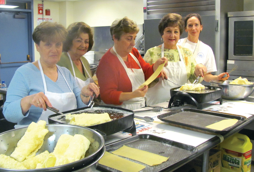 CHRISTMAS BAZAAR FOR A CAUSE: Among the many ladies who performed the delicate work making Greek Diples in preparation for this weekend's Philoptochos Ladies Society Christmas Bazaar are, from left: Roula Proyous, Diane Mitrelis, Koula Rougas, Georgia Pappas and Nancy Harritos.