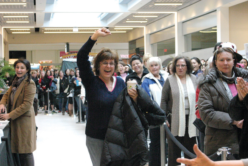 "SHOPPING SPREE: Bernice Dengal was the lucky winner of the ""Race Through the Rack"" sweepstakes, a 90-second $2,000 shopping spree through Nordstrom Rack, which opened at 9 a.m. at the Warwick Mall Thursday. More than 300 people attended pre-opening festivities, which began at 7."