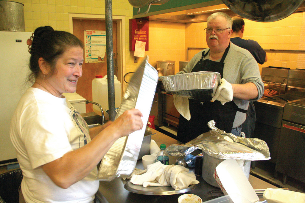 GUARANTEED HOMEMADE: Lori Bose and Ken Morse were among those who staffed the kitchen to ensure a varied breakfast and luncheon menu. The bazaar was held Saturday at Bishop Hendricken High School.