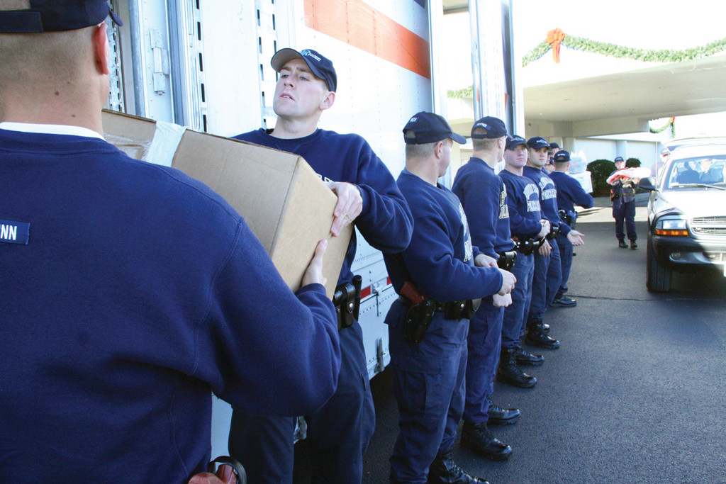 HELPING HANDS: Police Academy trainees and cadets helped load Aprin trucks as donors dropped off food, clothing and bedding to be delivered to New York victims of Hurricane Sandy Friday at Cardi�s on Route 2.