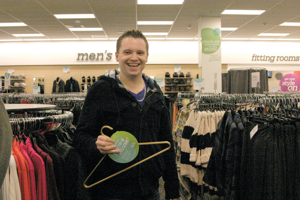 GOLDEN HANGER: Michael Bresette of North Providence found one of the 20 golden hangers hidden throughout the store. Each hanger was worth $100 of merchandise to be used that day.