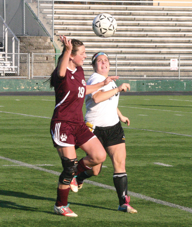 Haley McCusker battles for position on a header.