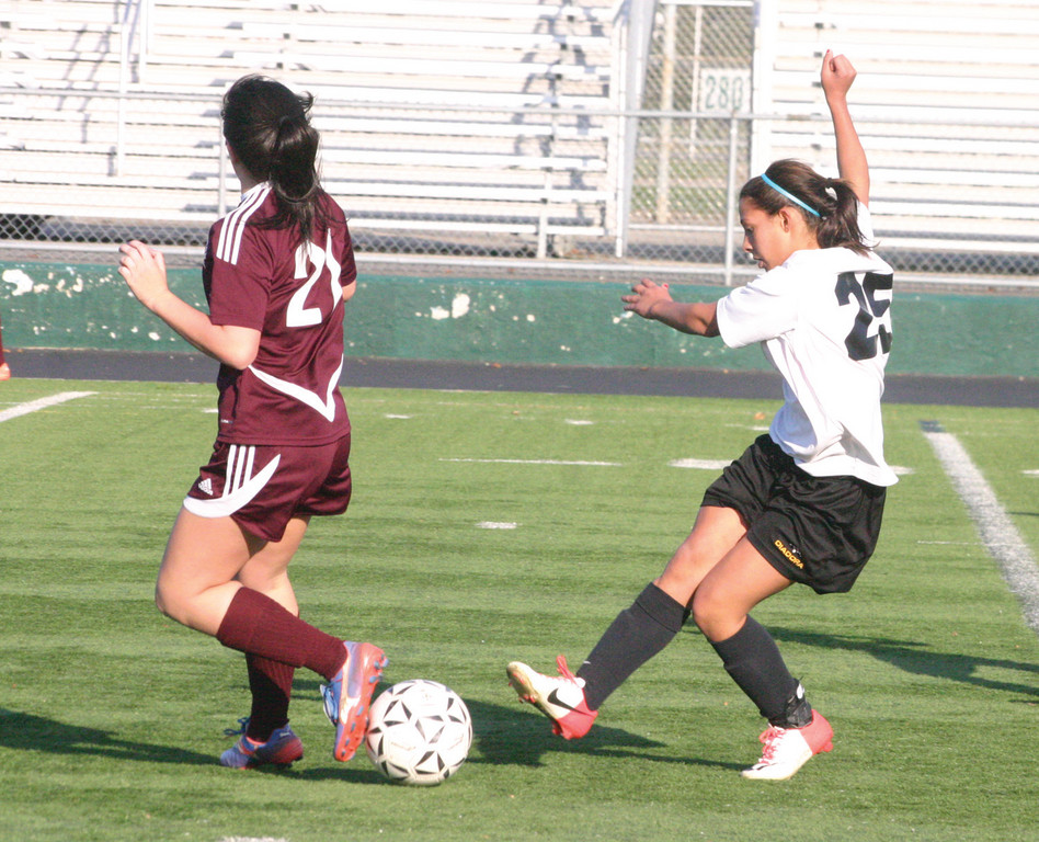 GOOD FIGHT: Katie Viera tries to control the ball as it lands between her and a Tiverton player.