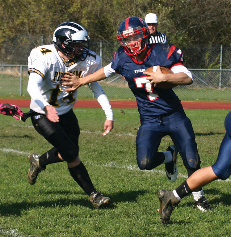 Toll Gate quarterback Aaron Travers tries to fend off Pilgrim's Zach Ponte.