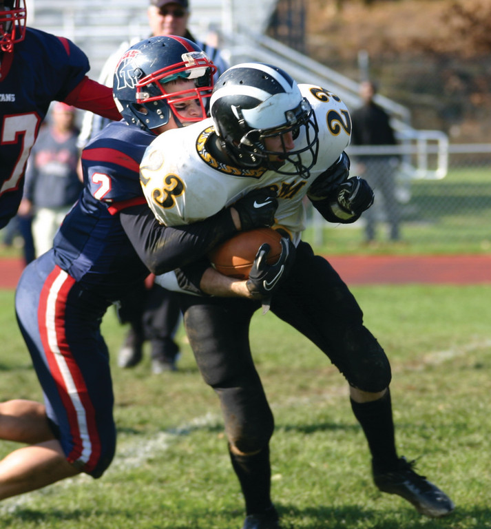 BATTLING: Pilgrim's Mike Kelly fights for extra yardage on a second-half run.
