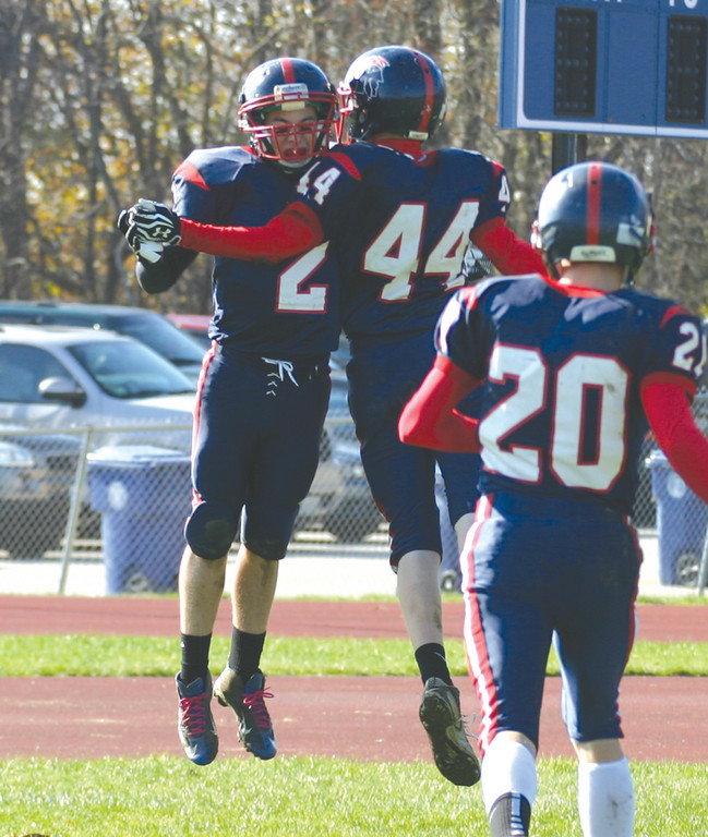 WINNING WAYS: Toll Gate's Joe Brosnahan (left) and Jacob Moran celebrate after Brosnahan's interception return for a touchdown gave Toll Gate a 14-0 lead on Saturday.