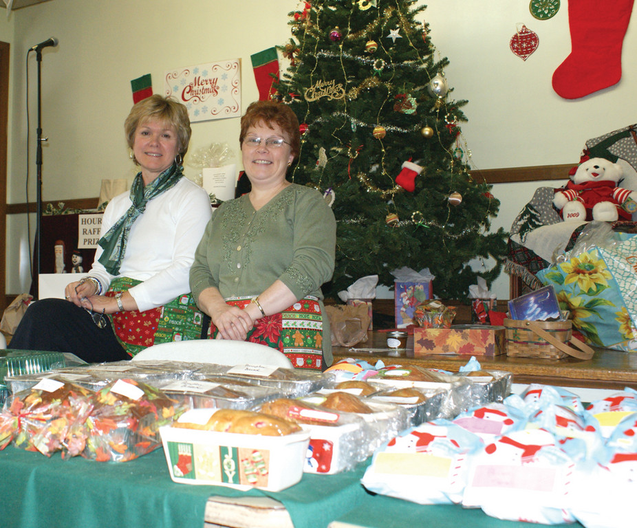A VISIT TO THE COUNTRY STORE: Marsha Southhard and Debbie Therrien sell baked goods during the Woodridge Church Holiday Bazaar this past weekend.