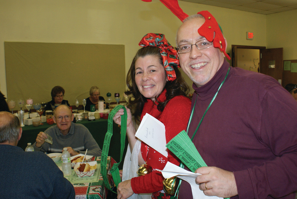TAKE A CHANCE: During the Woodridge Church Holiday Bazaar this past weekend, raffle ticket sellers Barbara Stifano and Assistant Minister Bob Nolan encourage people in the dining area of the one-day bazaar.