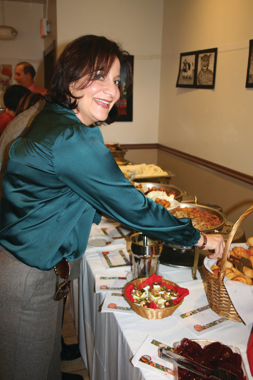 SO MUCH TO CHOOSE FROM: Assistant Superintendent Jeannine Nota-Masse helps herself to the buffet in the Meschanicut Room at CACTC last week.