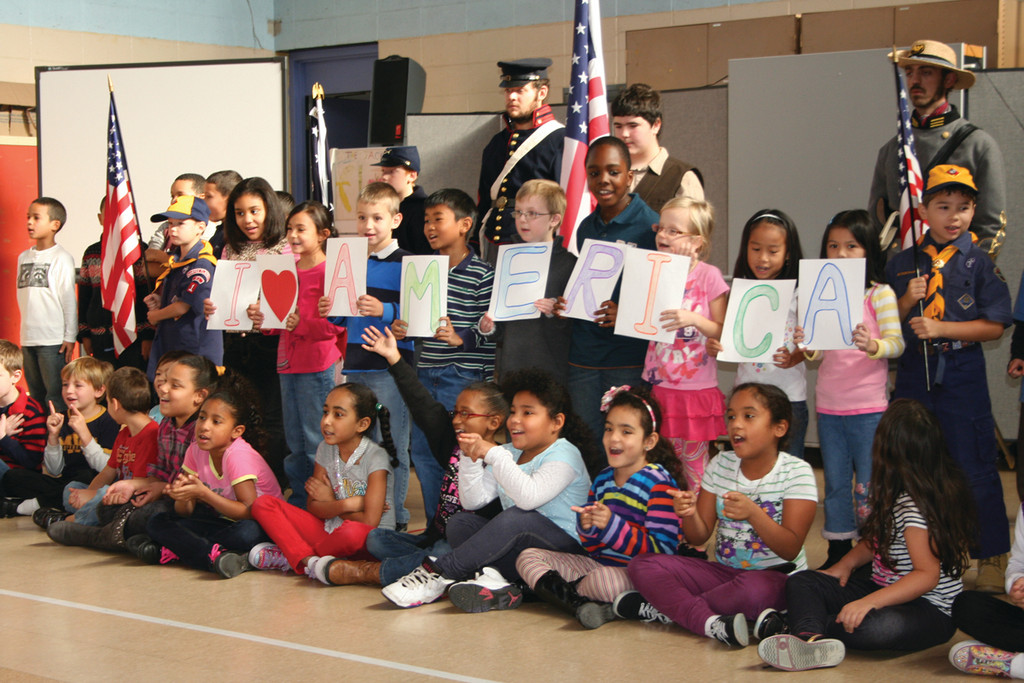 "PATRIOTIC TUNES: The second grade at Edgewood sang ""I Love America"" as part of Friday's ceremony."