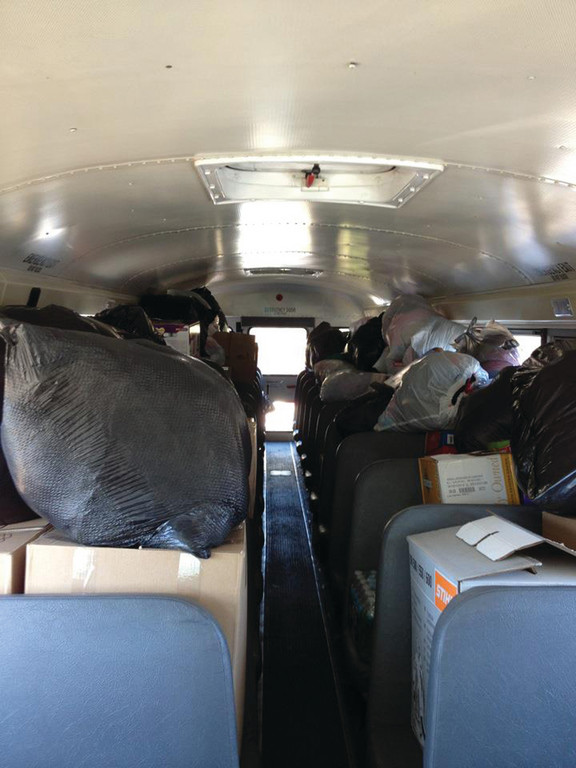 FILLING UP QUICKLY: The original plan of bringing one school bus of supplies quickly expanded to two, then three and finally even a fourth bus was filled with overflow donations, all of which were brought to New York and New Jersey this past weekend.