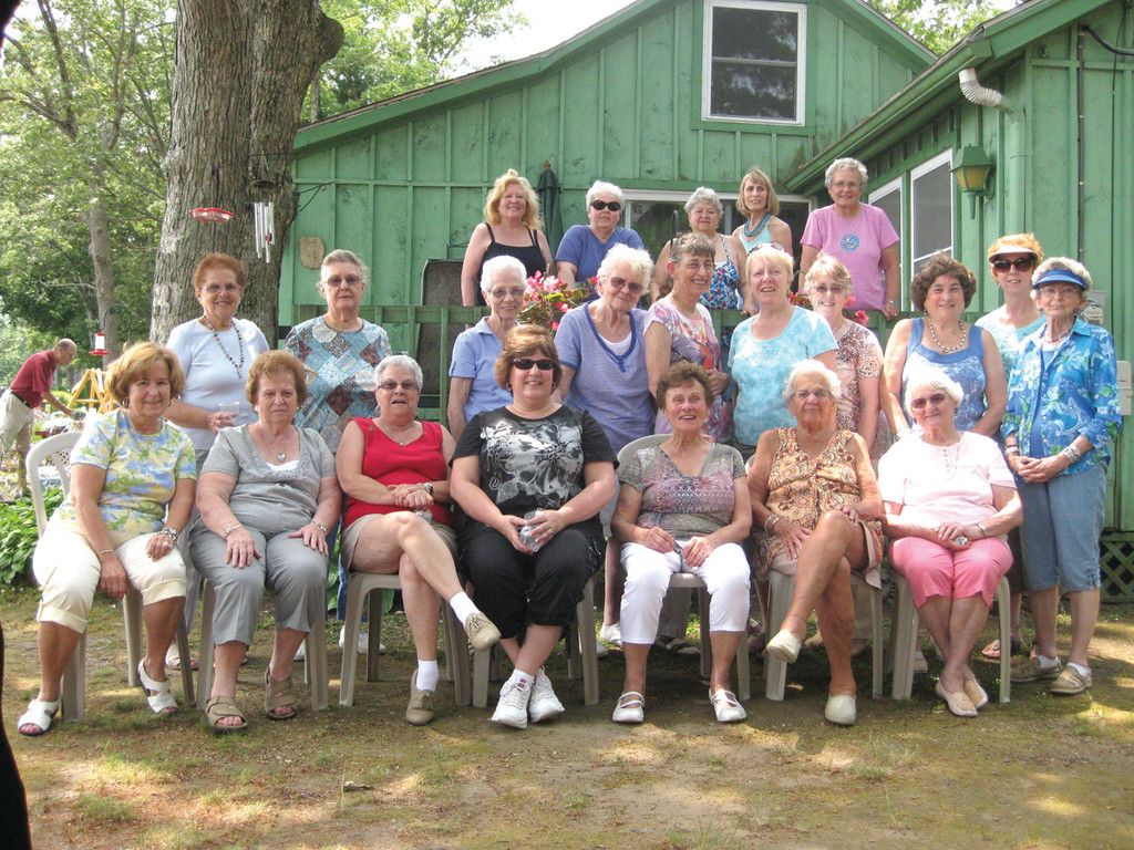 CROCHETING KINDNESS: To help provide those in need with a some warmth this winter, The Active Older Adults Knitting Club is holding their 12th annual Christmas Giveaway Dec. 7 to benefit 14 select Rhode Island charity organizations. The AOA are shown here during an event during the summer.