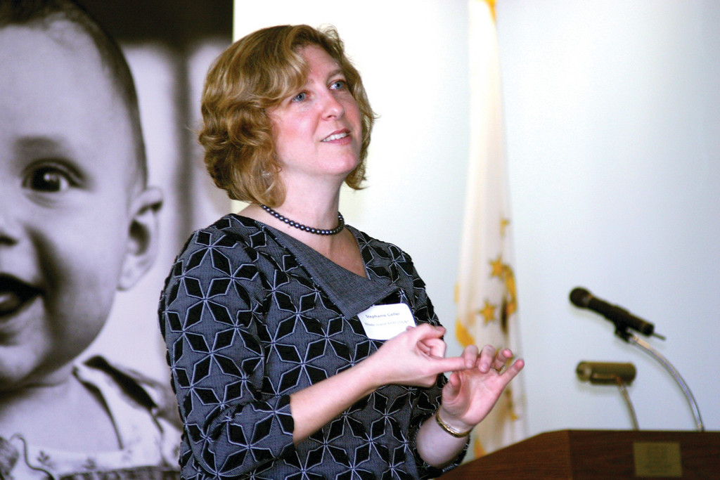 BY THE NUMBERS: Stephanie Geller, policy analyst for Rhode Island Kids Count, discussed trends regarding Warwick's youth with officials and advocates yesterday morning.