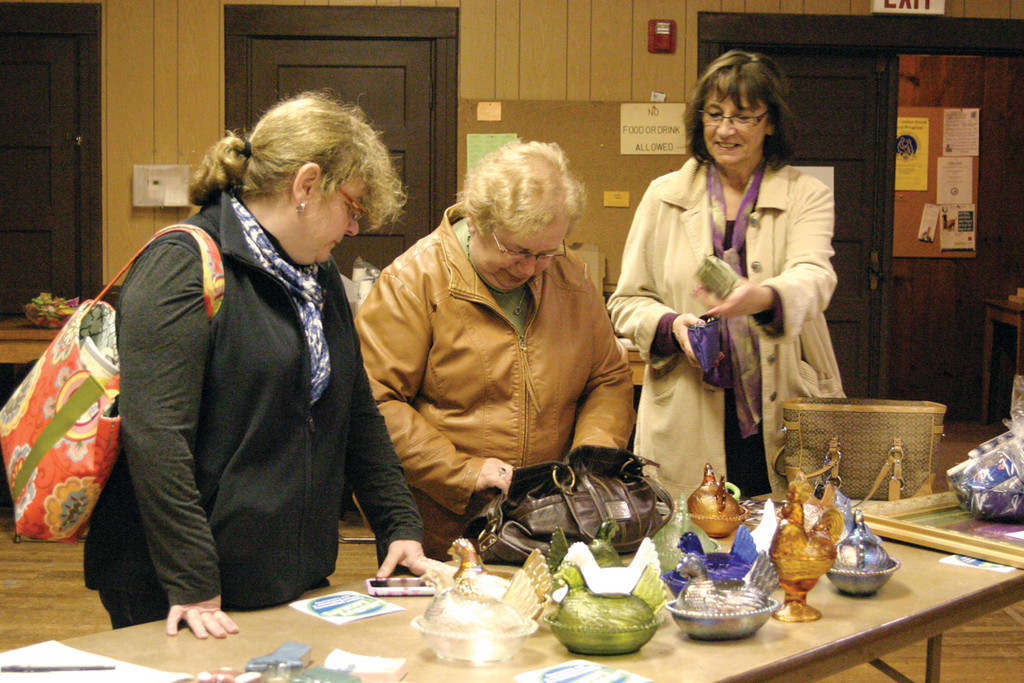 BIDDING FOR A BENEFIT: More than 30 people gathered at the event, including members of LBL and OSA. They include Stacy (left), Carol Pratt of Carol's Country Corner, and OSA Vice President Norma McEntee, all of whom left the auction with items they bid on.