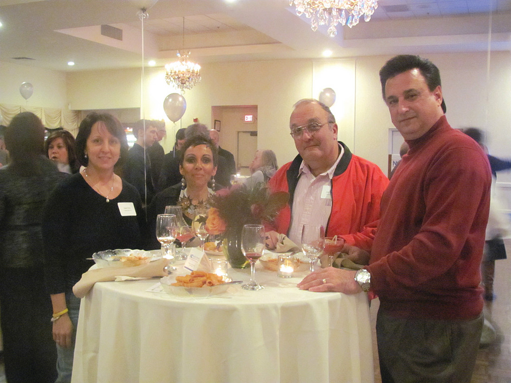 Among the many people and business owners who enjoyed last Thursday�s event were, from left: Gwen Perry of Eramian Signs, entertainer Janine D�Angelo, Eramian Signs owner John Eramian and Mike Raspallo of Corner Office Financial.