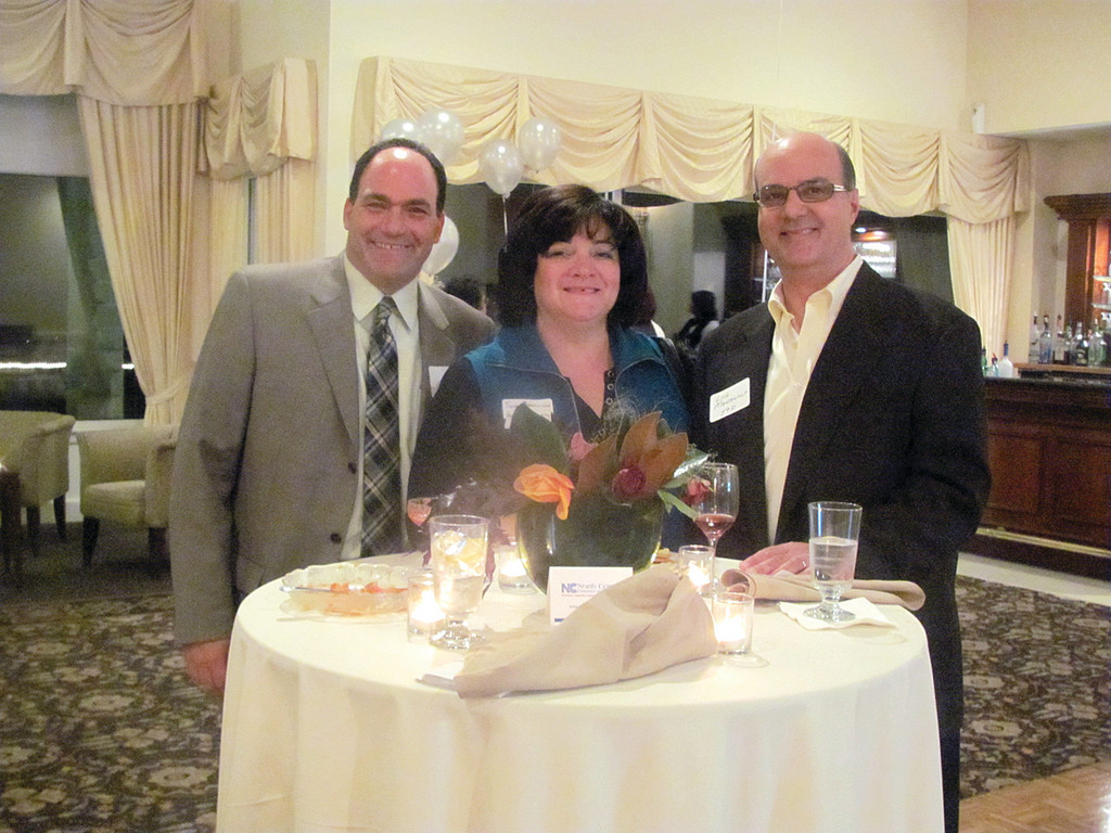 Randy Russo (left), director of community relations at The Village at Waterman Lake and board chairman for the North Central Chamber of Commerce, joins Lou and Susan Mansolillo at last Thursday's 30th anniversary celebration held at Kirkbrae Country Club in Lincoln.
