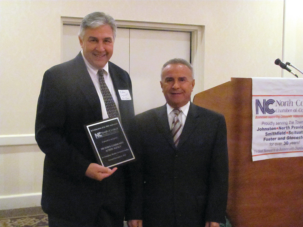 Matt Guglielmetti, emergency services director of Tri-Town Community Action Program, gets a congratulatory greeting from North Providence Mayor Charles Lombardi at last Thursday evening�s North Central Chamber of Commerce 30th anniversary celebration.