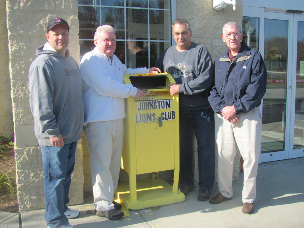 Johnston Lions Club President Joe Swift (second left) puts two pairs of used glasses into the mailbox that the non-profit club recently installed at the Johnston Senior Center. He is joined by Vice President Vito Georgio, Board Member Chris Giardina and Club Member Al Savage. The JLC last year collected upwards of 5,000 used glasses that were sent to third world countries and made into new glasses.