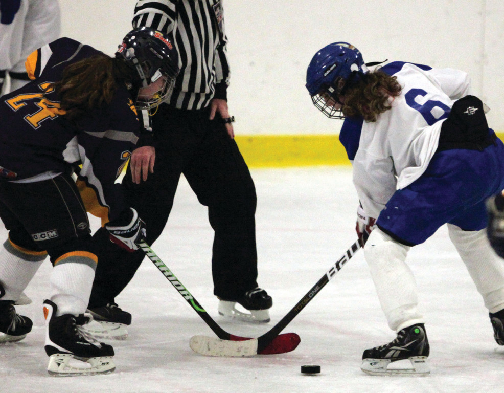 Madison Balutowski battles for the faceoff.