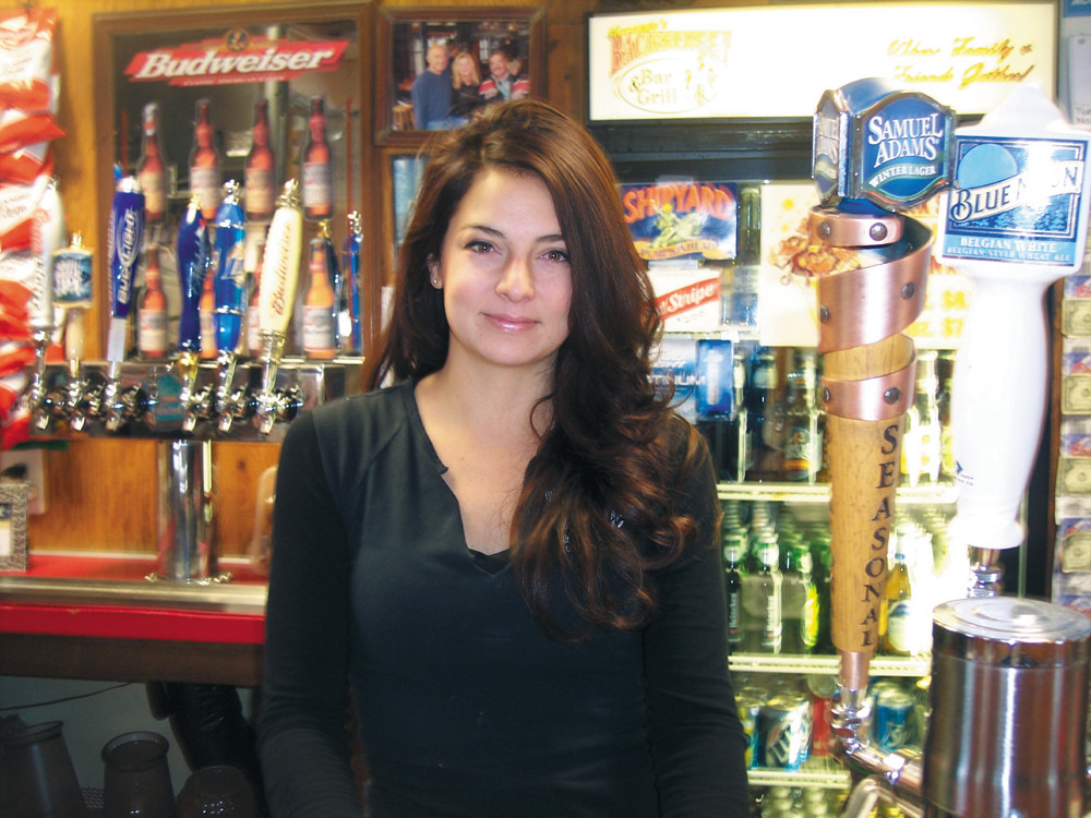 Bartender Briana Derry will serve you up a thirst-quenching drink as you cheer on the Patriots, or just need an escape from the cold.
