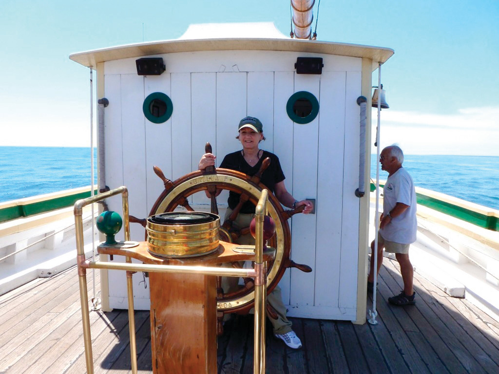 AT THE HELM: Former Warwick resident and assistant professor Kathy Vespia of East Greenwich took a cruise on a tall ship this summer that convinced her Rhode Island needed its own sailing school vessel, which it will have when construction of the SSV Oliver Hazard Perry is completed next year.