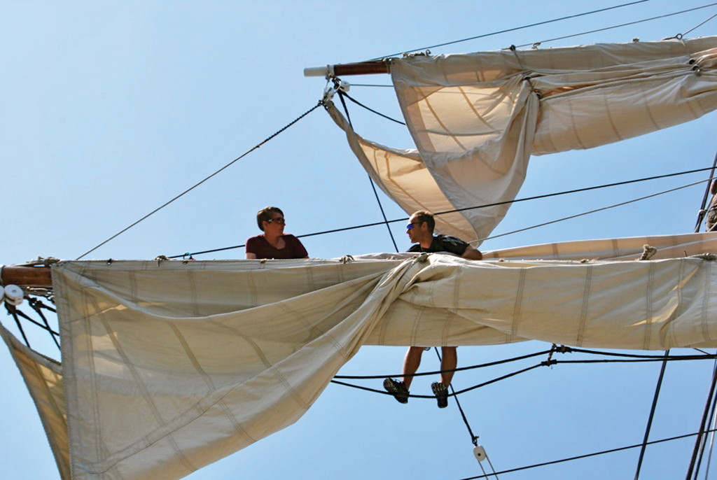 ALOFT: Math teacher Adam Cherko (right) of The Greene School in West Greenwich goes aloft on the tall ship Gazela with a crew member.