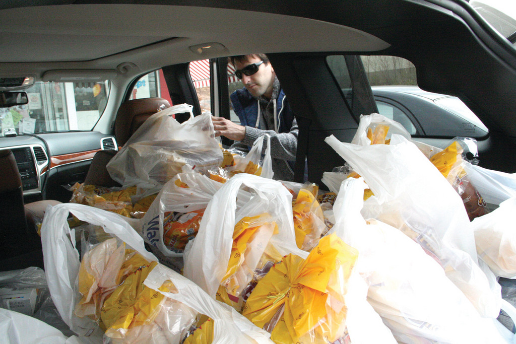 Dan Petrocelli, director of  Precious Angels Childcare, loads 30 loaves of bread in his van after what could be his last shopping visit to the Wonder Hostess outlet.