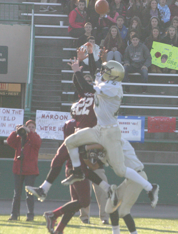Safety Billy Mueller leaps into the air to break up a long pass attempt.