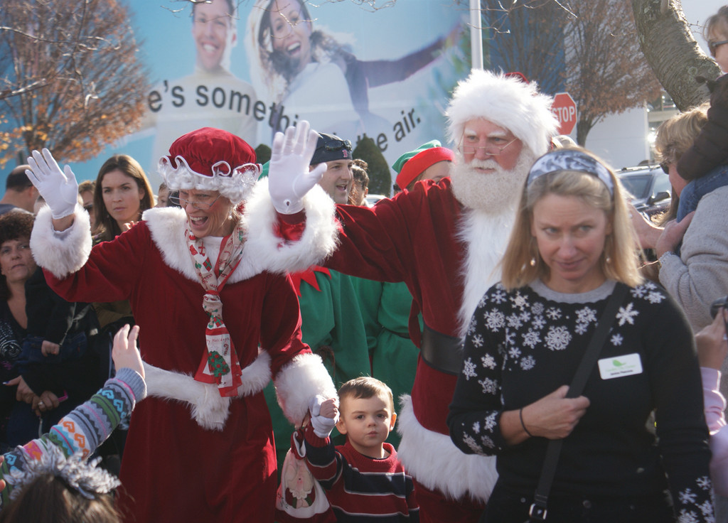 ROLLING IN: Mr. and Mrs. Claus arrive in Garden City Center last year. They will make a return visit this Saturday from 11 a.m. to 2 p.m.