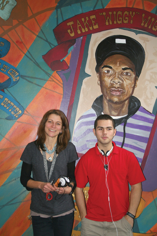 Justin Espinal and Anne Kugler, youth director for AS220, were two of 20 program coordinators and participants to travel to Washington, D.C., to accept a national award during a reception at the White House. Behind them is a mural created by AS220 students.