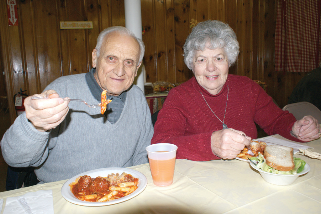 LOVEBIRDS: Frank and Kathleen Manzi, members of the Oaklawn Grange, are both thankful that the family is in good health.