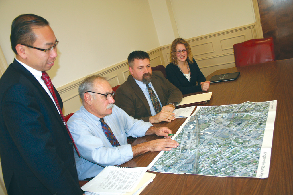 MAKING A PLAN: Surveying plans for Knightville are Mayor Allan Fung, Planning Director Peter Lapolla and planners Nathan Kelly and Krista Moravec from Horsley Witten Group.