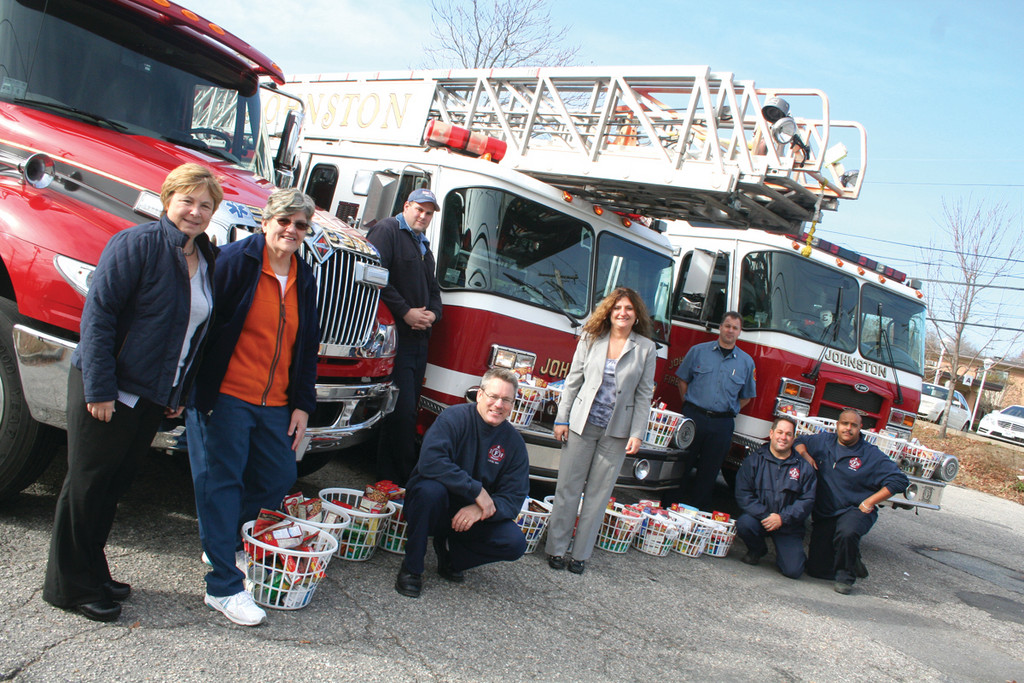 Johnston Firefighters and representatives from local schools gather on distribution day before the baskets can be passed over to deserving families throughout the district.