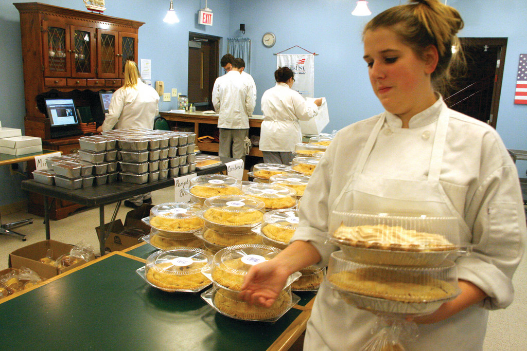 HANDFUL OF PIES: Ashley Taylor, a senior who plans to study at CCRI next year and then transfer to Johnson & Wales University, fills an order. She found making apple pies the most difficult.