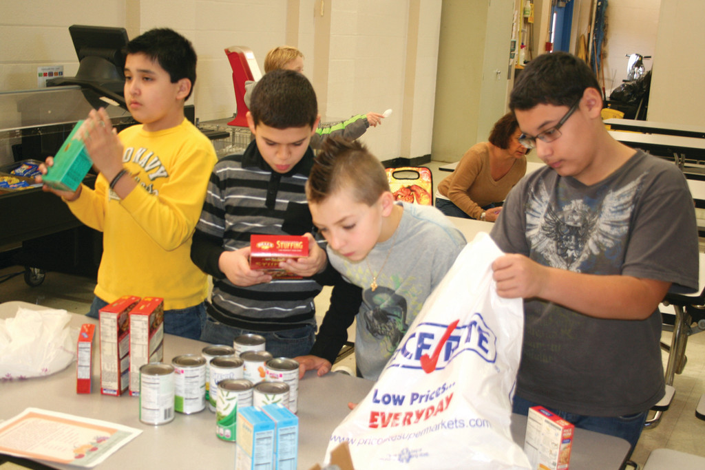 Carlos Fragoso, David DiOrio, Eddie Melvin and Rudy Landin help to sort out the donated foods.