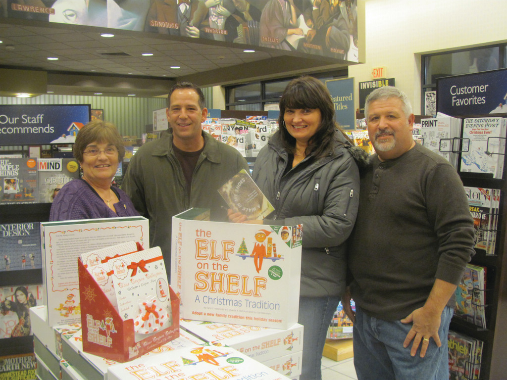 Karen Shewcov, Ryan�s mother, is joined by her brother-in-law Guido Gosetti, her sister Colleen Gosetti and husband Carl Shewcov at her son�s book signing last week in Smithfield.