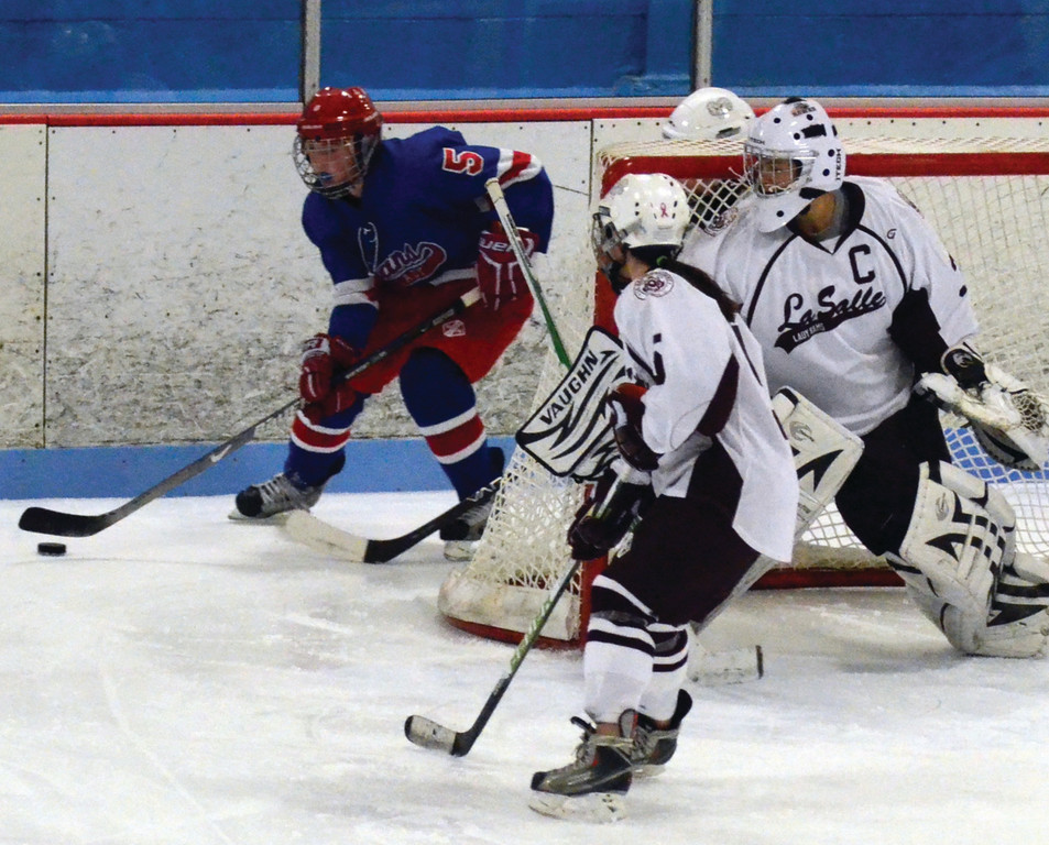 BACK LINE: Abby Ellis carries the puck behind the net in a game last year.