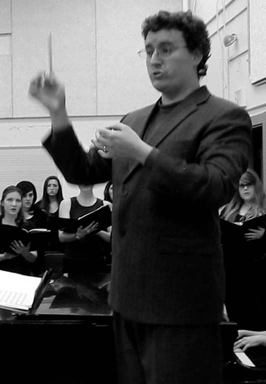 Andrew Howell conducts the URI chorus.