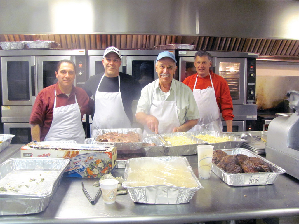 IN THE KITCHEN: People who took in the Christmas Bazaar enjoyed lunch and dinner cooked by the Church of the Annunciation's volunteer cooks Gaby Daiaa, Dennis Sampalis, Master Chef Harry Bablenis and John Massenzio.