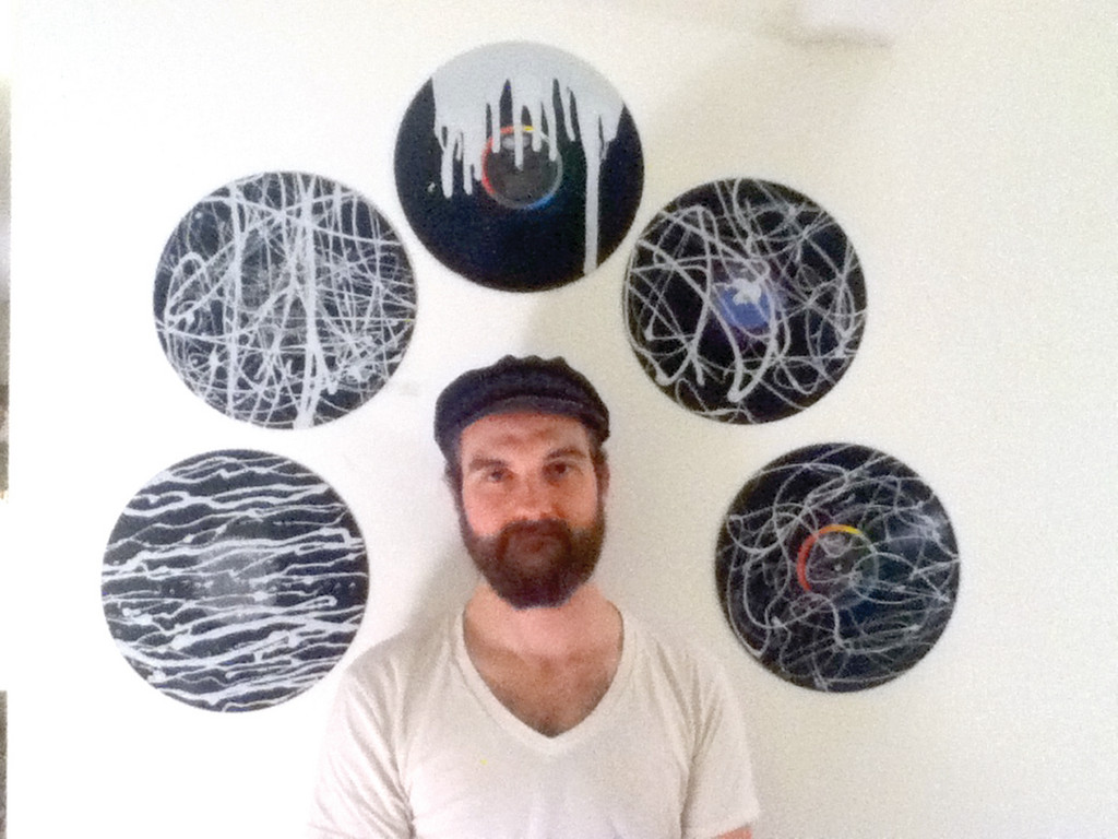 ON THE RECORD: Brad Caetano of Warwick is pleased his artwork will be part of the sale. The artist uses high-gloss vinyl paint and old records to create one-of-a-kind pieces.