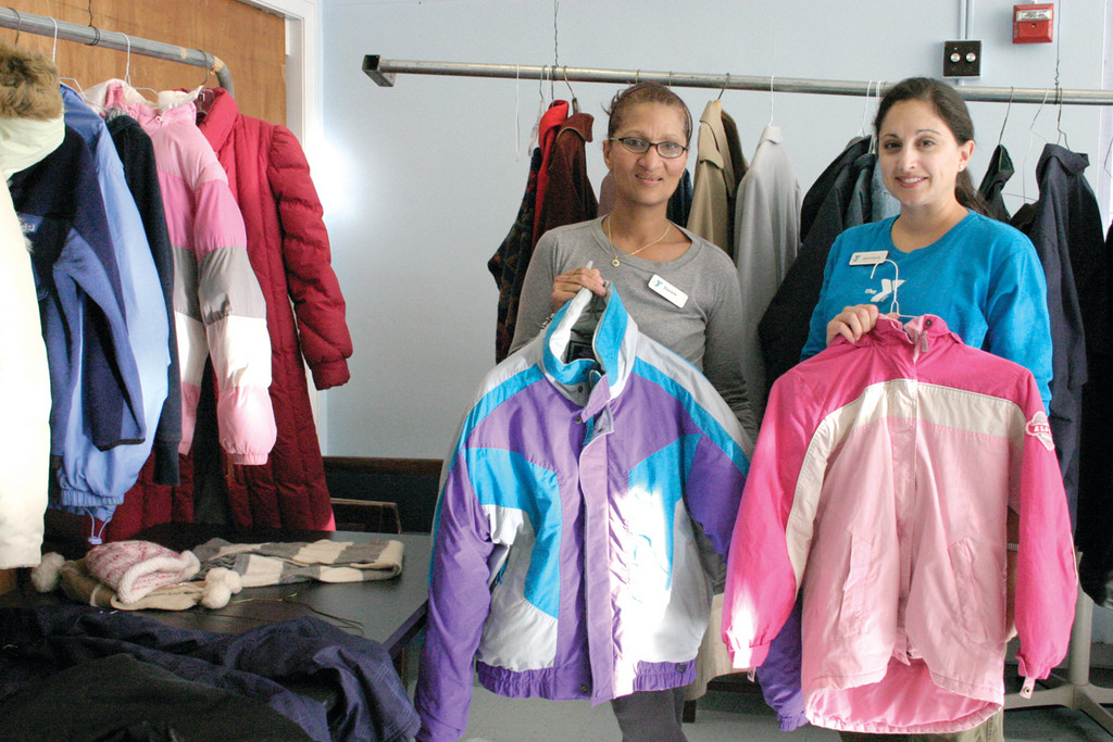 COATS OF ALL SIZES: �We�ve been having a lot of families come in with young kids,� said Danielle Healy (left) the wellness representative at the Cranston YMCA, who stands with Jeanmarie Pariseau, executive assistant to the director.