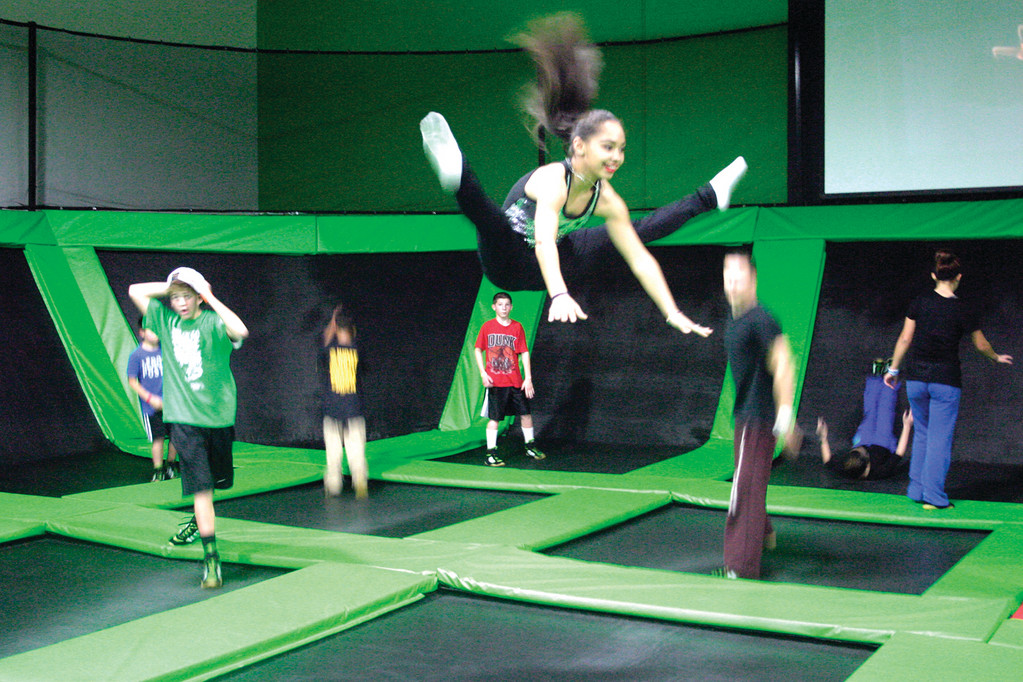 JUMPING GOOD TIME: Former New England Patriot player Ty Law opened Rhode Island's first indoor trampoline park Friday. Cranston resident Dalila Fabian, 11, does toe-touch midair at Launch Trampoline Park.
