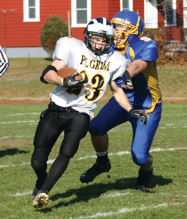 CHASE: Pilgrim's Mike Kelly tries to slip out of grasp of Vets linebacker Tim Hogan on Thursday.