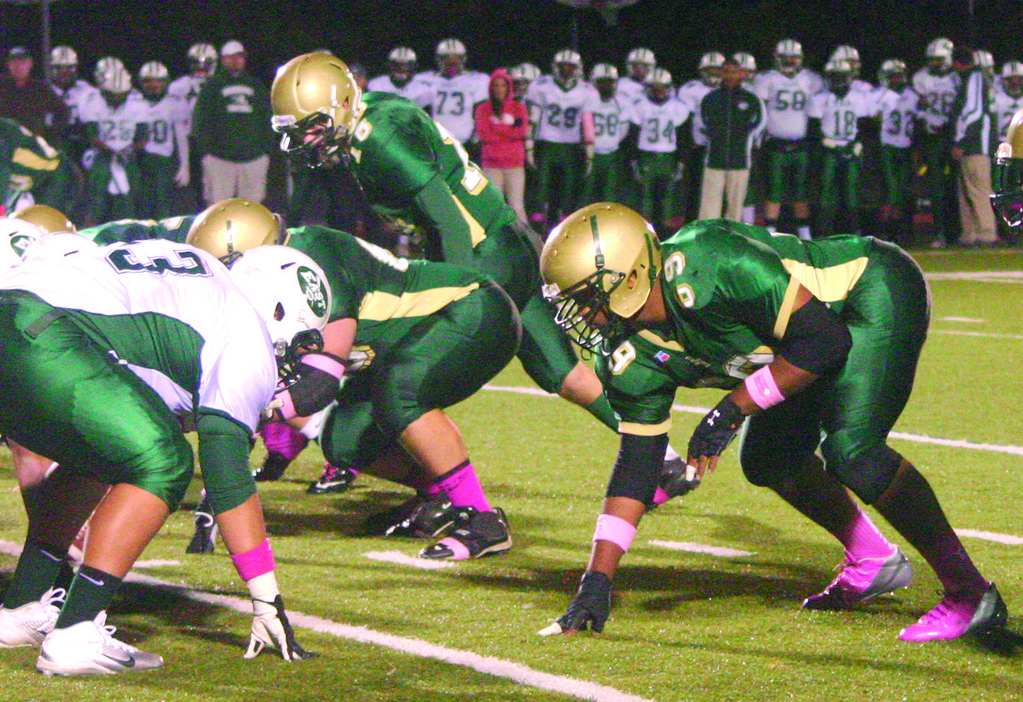 READY TO RUSH: Hendricken's Mario McClain lines up opposite an East lineman in the regular season meeting between the teams. Pressure by McClain and Jarrid Witherspoon was one of the main reason for Hendricken's win.