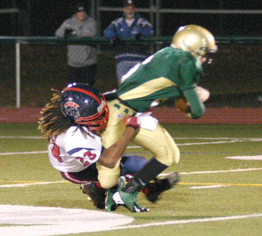 Chris Durand sacks Hendricken quarterback Patrick Gill.