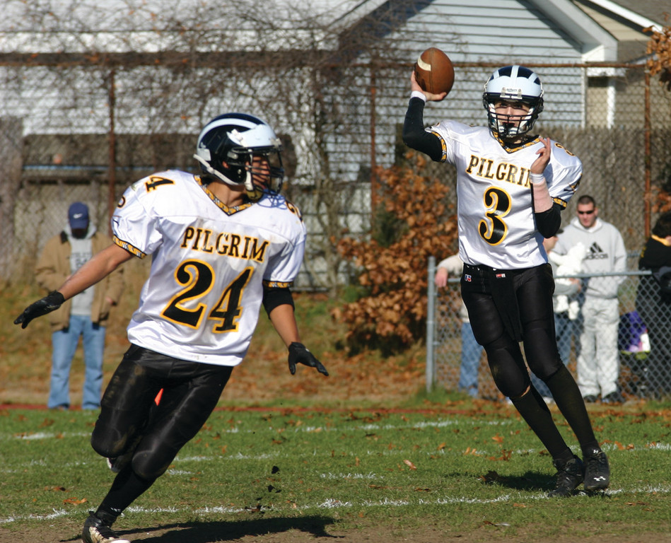 SWING IT: Pilgrim quarterback Rob Quaine looks for Davien Brown out of the backfield.